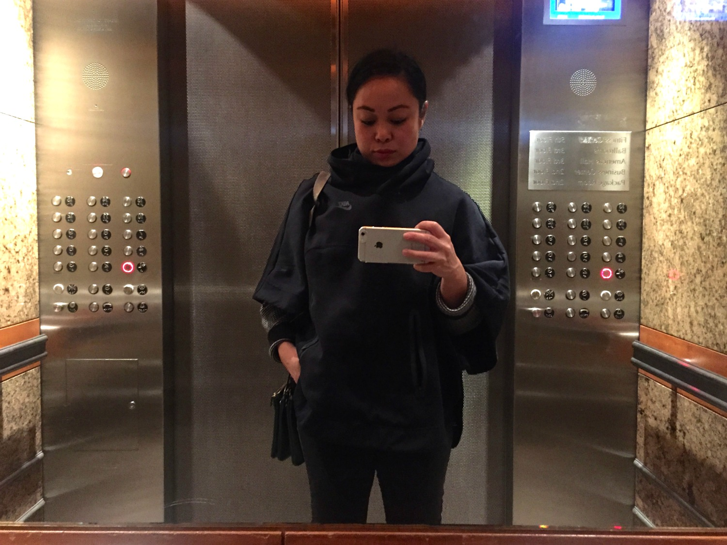Elevator Selfie - solo traveler photo tips